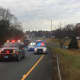 Traffic is jammed on I-84 after a car rolled down an embankment off Exit 7 eastbound in Danbury on Wednesday morning.
