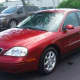 The two may be traveling in a red Mercury Sable with Florida tag Z04CSC, similar to this one.