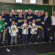Yonkers Mayor Mike Spano with the gear donated by the NHL Players' Association to help outfit the Yonkers Force hockey team.