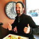 Clark Moore, general manager of The Red Pony in Rye, shows off a cheese plate.