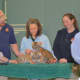 The Amur tiger cubs born at Beardsley Zoo in November bask in the media glow with (l-r) Bridgeport Mayor Joe Ganim, zookeeper Chris Barker, vet tech Jenny Gordon and zookeeper Bethany Thatcher.