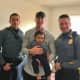 Officers Brad Gilmoure and Kenneth Knebl and Sgt. Justin Tress met baby Lyon Judah Garcia at his home on Sunday.