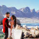 Marry Me In: Cape Town, South Africa. Nick and Zoe Aust are traveling the world, taking pictures in their wedding clothes. They quit their jobs and are funding the excursion with their life savings.