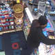 New York State Police investigators have released surveillance photos of a suspect implicated in an armed robbery at a Cortlandt gas station.