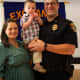 "Chris DeFalco with his family. He was named ""Officer of the Year"" this week by the Ridgefield Police Department."