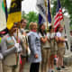 Hillary Clinton with girls scouts at the New Castle Memorial Day Parade.