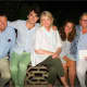 Three of the victims of the plane crash are shown in this photo posted by Martha Stewart, center. They are: builder Ben Krupinski (far left), grandson William Maerov (second from left), and Bonnie Krupinski (far right).