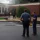 Firefighters are working to determine the cause of a fire that heavily damaged at least one classroom on the first floor of a Ridgewood elementary school on Wednesday morning.