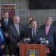 Officials announcing the arrests in Yonkers.