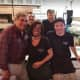 Dan Lauria poses with staffers at Frank Pepe's Pizzeria in New Haven earlier this month.