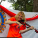 Rotarian Daisy Jopling providing some live entertainment on her fiddle during a past Peekskill Horse Show & Country Fair.