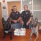 Officers with the cash that was seized.