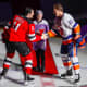 Burgida, 11, drops the ceremonial first puck Friday for NJ Devil Brian Boyle and NY Islander Anders Lee.