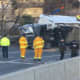 A tractor-trailer overturned on Route 495 westbound Wednesday morning.
