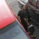 A man was caught on camera sneaking out of a van before stealing a car with a child inside in Deer Park.