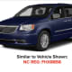 A 2004 blue Chrysler Town and Country minivan.