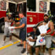 Tyree Ward of Philadelphia was welcomed as a hero by Wildwood firefighters, and then taped a video of his water rescue with his wife and child (right)