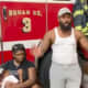Tyree Ward of Philadelphia, with his wife and child, is interviewed at Wildwood Fire Department about how he rescued a 20-year-old woman from drowning.