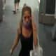 An unidentified woman, captured on surveillance footage, who stole over $200 in cosmetics and another merchandise.