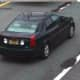 The unidentified woman was a passenger in the pictured black Cadillac with no front plate or identifiable markings that was operated by a black male.