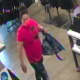 A still, captured from surveillance footage at Old Navy, of the wanted man.