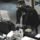 The New Canaan Police Department released new photos of suspects implicated in a bank robbery.