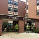 Firefighters enter George J. Conway Towers to battle a third-floor kitchen fire and rescue a tenant.