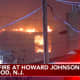 A four-alarm fire destroyed the Howard Johnson Express Inn on North Black Horse Pike overnight. (Courtesy: Chopper 6 ABC-TV News)
