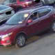 The suspect allegedly stole a television then left in this red Nissan Rogue.