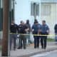Detectives investigate a fatal shooting about a block from the police station in Paulsboro. (Courtesy: 6ABC-TV News)