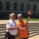 Bergen County Sheriff Michael Saudino lights a torch
