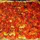 "The ""Grandma Pizza"" is a Sicilian-style pizza with fresh tomatoes, basil, extra virgin olive oil and garlic."