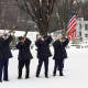 Wyckoff-Midland Park VFW members fire rifles at the December ceremony.