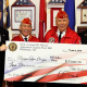 Hillsdale Mayor Doug Frank and American Legion Post 162 Post Commander Phil Langer present a check to Joe Piazza and George Vankat of the Marine Corps League.