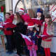 Carolers serenade holiday shoppers in Bronxville.