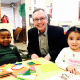 Family Centers' CEO Bob Arnold is shown with a child from The Grauer Preschool.