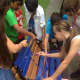 Concord Road School students paint the Buddy Bench.
