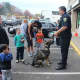 An officer from the Fairfield Police Department and a member of its K9 Unit visit with children during a recent fundraising event.
