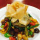 Artichoke bottom stuffed with Wild Mushrooms. Baked in a Phyllo Pastry served with vegetables.