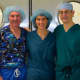 From left, Dr. Lee Eisenberg, Dr. Robin Brody, and Dr. Dan Grinberg volunteer at a facility.
