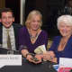 Mary Prenon, center, enjoys the gala with Philip Weiden, left, and Leah Warncke.