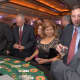 Guests gather at a card table at the gala.