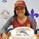 New Rochelle student-athlete Jennyfer Huerta celebrates with a cake after signing a letter of intent to attend St. Thomas Aquinas College this fall.