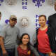 New Rochelle student-athlete Jennyfer Huerta is surrounded by her parents during the signing ceremony this week. At far right, is coach Andy Capellan. At far left is Steve Young, the district's director of athletics.