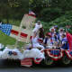 The New Fairfield Board of Selectmen are shown aboard a patriotic float in the town's July 4th parade.