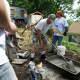 Benjamin Emanuel (orange bandana) and ING volunteers work on 120 High Street, Veteran build, Yonkers. June 28, 2013