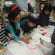 Westchester Day School students create a mural to be donated to the Spring Brook Manor Nursing Home in Scarsdale.