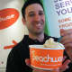Manager Ryan Ventura holds up a frozen yogurt at Peachwave, a new frozen yogurt business in New Canaan. It is located at 11 Forest St.