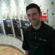 Manager Ryan Ventura stands by the eight self serve machines at Peachwave, a new frozen yogurt business in New Canaan. It is located at 11 Forest St.