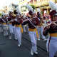 Members of the Harrison High School marching band perform on Main Street USA in Disney World.
